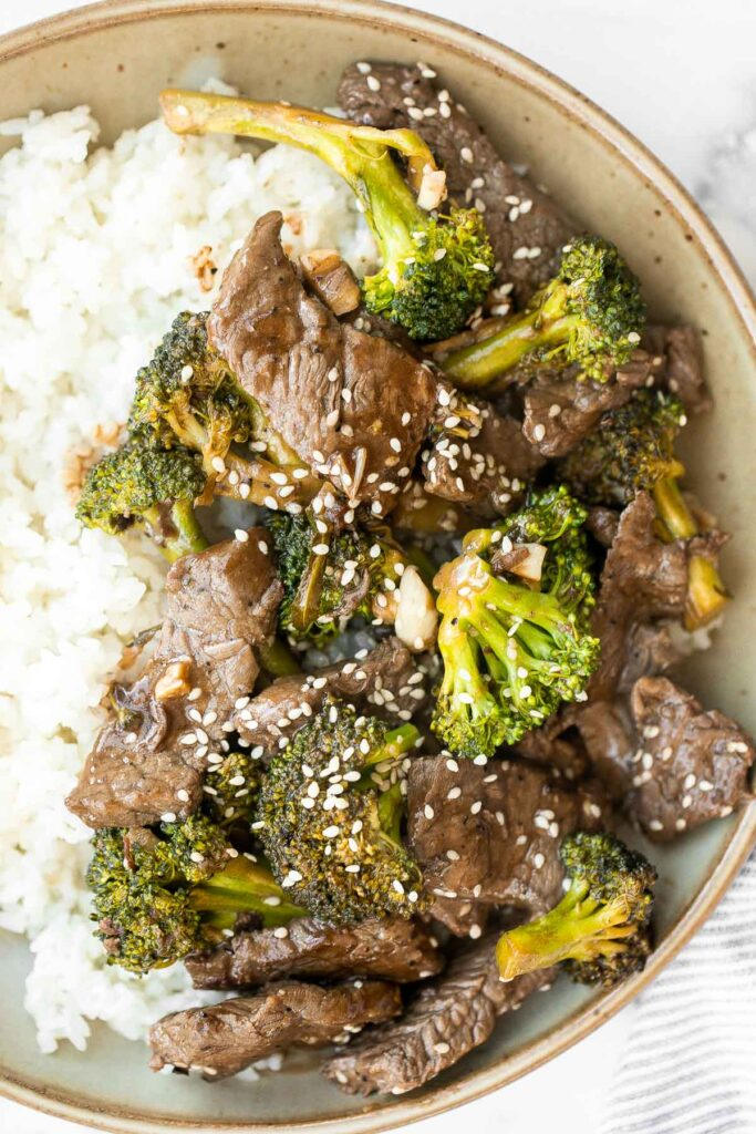 Beef and broccoli stir fry is a classic Chinese-American dish that is delicious, savory, hearty, and saucy. Better than takeout and ready in 25 minutes.   aheadofthyme.com