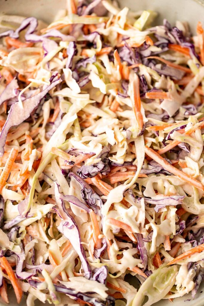 Fresh, crisp, classic coleslaw salad is a must-have recipe for a summer barbecue or picnic, or as an easy make-ahead lunch. Make it in less than 10 minutes. | aheadofthyme.com