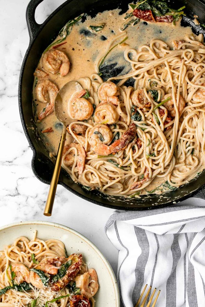 Creamy shrimp pasta with sun-dried tomatoes is a delicious, quick and easy meal that takes just 20 minutes to prep and make. The perfect weeknight dinner. | aheadofthyme.com