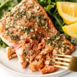 Greek salmon is delicious, flaky, and tender. This healthy oven-baked salmon is packed with Mediterranean flavors and is ready in just 20 minutes. | aheadofthyme.com
