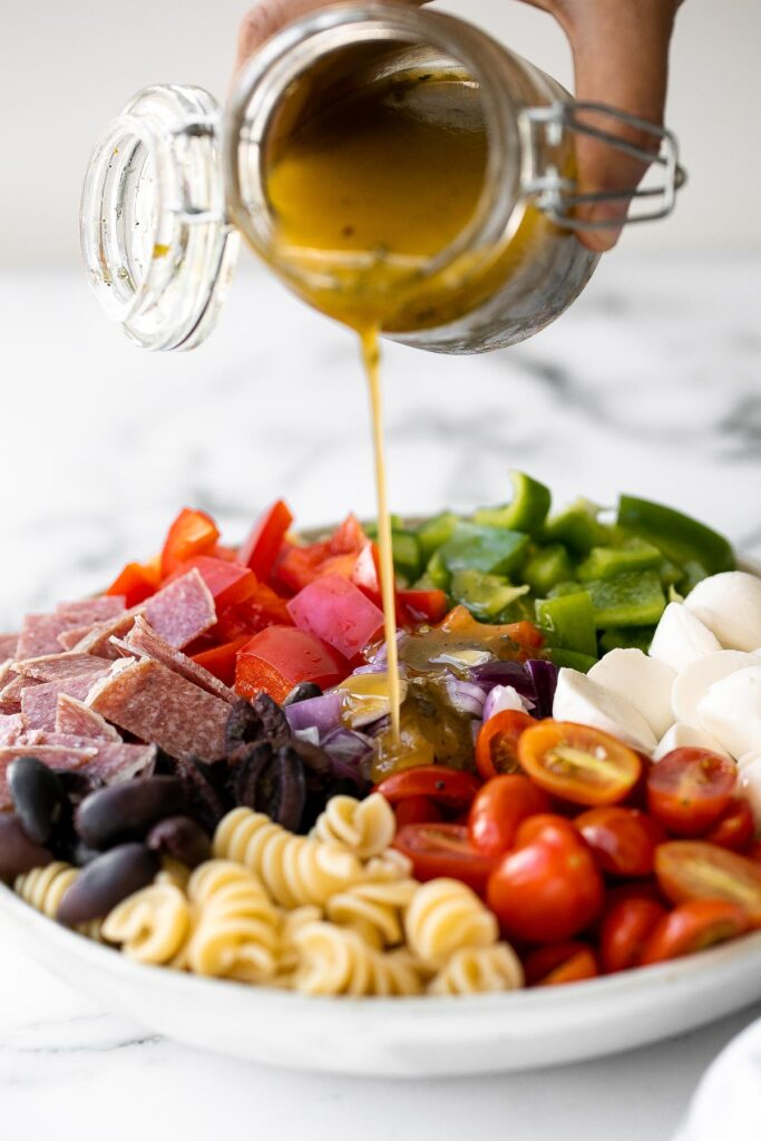 Italian pasta salad is delicious, wholesome, and easy to make. Make it up to three days ahead for your summer picnics and cookouts. | aheadofthyme.com