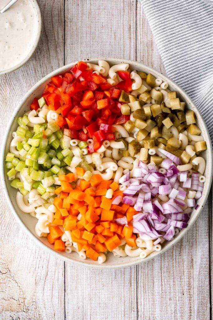 Classic macaroni salad is a creamy and delicious pasta salad that is easy to throw together. It's the perfect side to bring to a summer potluck or BBQ. | aheadofthyme.com