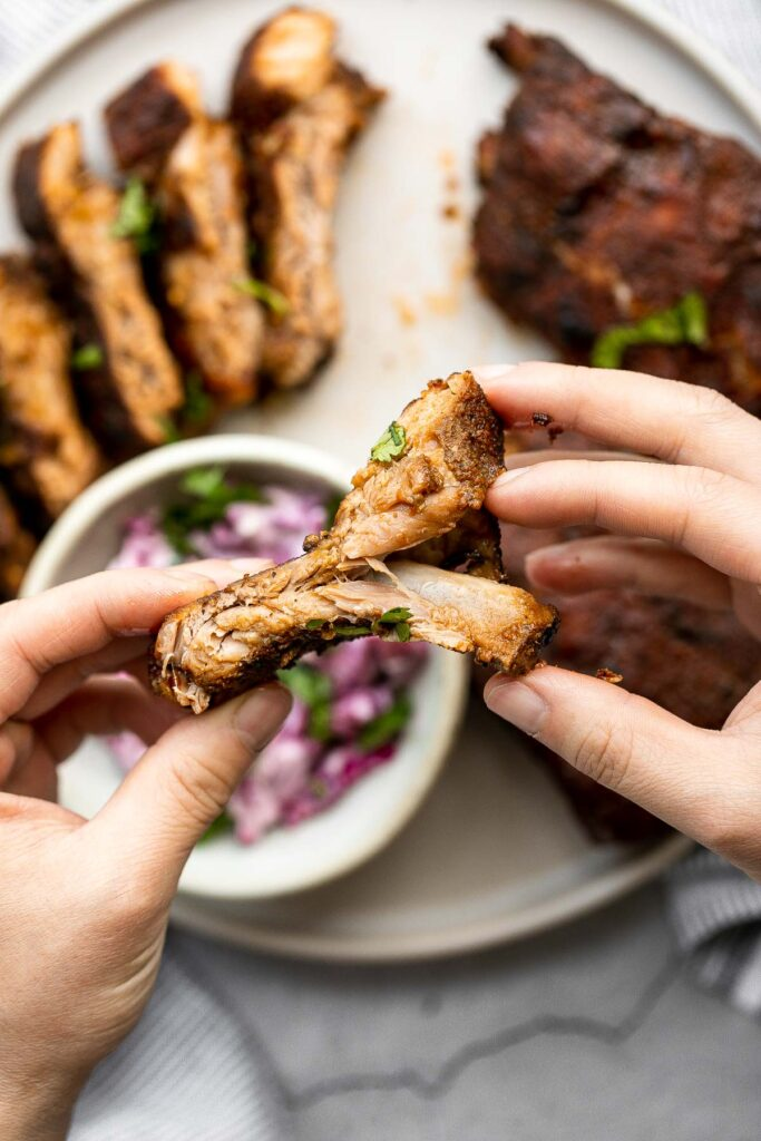 Slow cooker BBQ ribs are juicy, saucy, and tender -- the meat literally falls right off the bone. Add this easy recipe to your list of crockpot recipes. | aheadofthyme.com