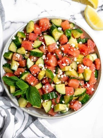 Watermelon feta salad with cucumbers and mint is a simple and delicious refreshing summer salad that you can toss together in 5 minutes. | aheadofthyme.com