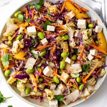 Asian chopped salad is a delicious and colorful salad, loaded with refreshing crisp vegetables, plant-based protein, and a homemade creamy sesame dressing. | aheadofthyme.com