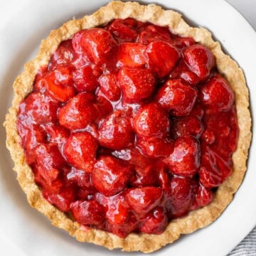 Fresh strawberry pie is a delicious, summer dessert loaded with juicy strawberries and homemade strawberry glaze with no jello, in a flakey pie crust. | aheadofthyme.com