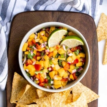 Fresh mango salsa is sweet, tangy, and delicious. It's a quick and easy recipe that you can whip up with just 6 ingredients and in under 10 minutes. | aheadofthyme.com