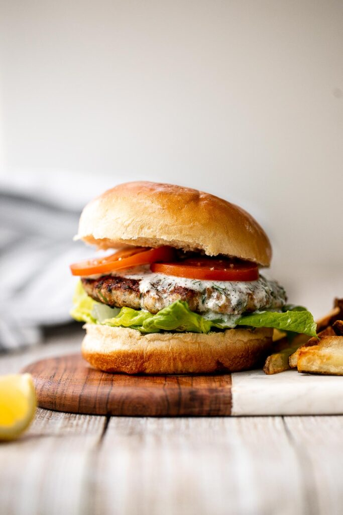 Mediterranean turkey burgers are tender, juicy, and delicious, loaded with garlic, fresh dill, and lemon juice. The perfect summer weeknight meal. | aheadofthyme.com