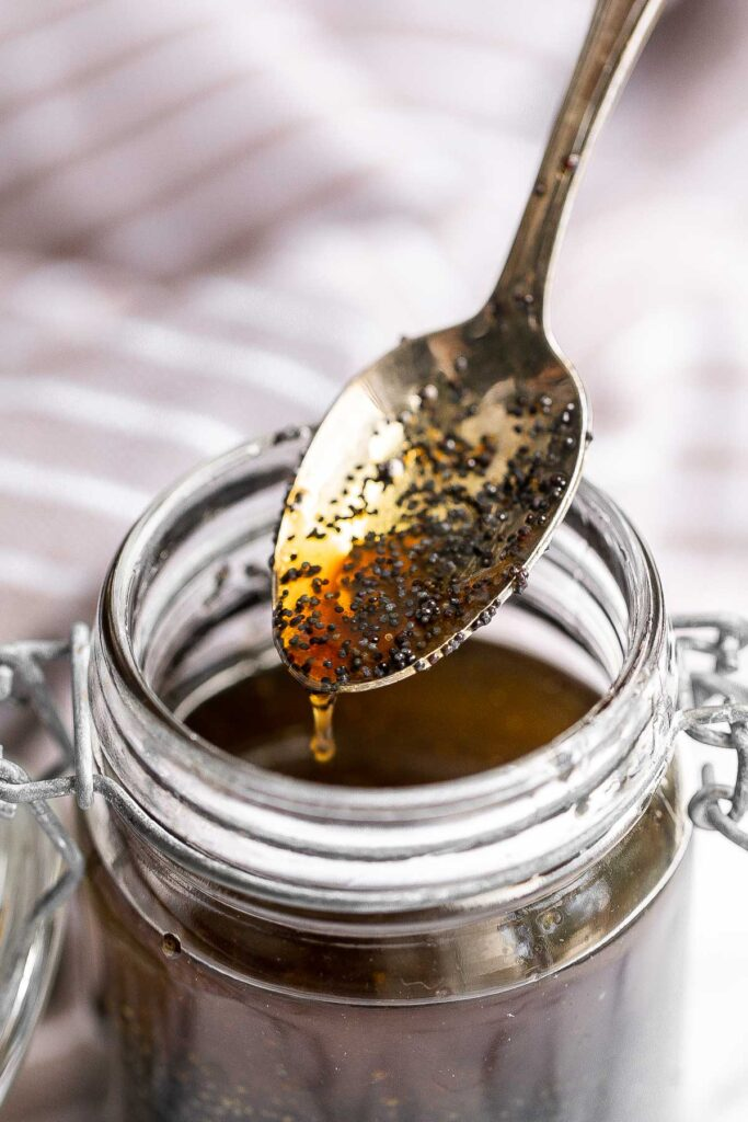Homemade poppy seed dressing is sweet, savory, and fresh. It's a quick and easy olive oil and balsamic salad dressing that is loaded with poppy seeds. | aheadofthyme.com