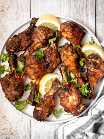 Tandoori chicken drumsticks are crispy outside, juicy and tender inside, and packed with flavor. An easy dinner to make in the oven, stovetop, or grill. | aheadofthyme.com