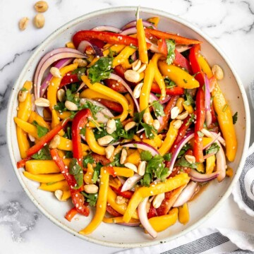 Thai mango salad is a refreshing and healthy dish that makes a great summer lunch or side dish. Easy to throw together in 10 minutes. | aheadofthyme.com