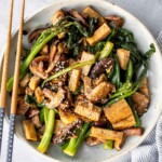 Quick, easy, and simple, vegan tofu and mushroom stir fry is a delicious meal that is ready in under 15 minutes. Serve it over a bowl of steamed rice. | aheadofthyme.com