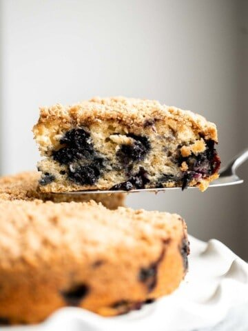 Blueberry buckle cake is soft and moist, loaded with fresh blueberries, and has a crunchy, sweet and buttery streusel topping. It's the best coffee cake.   aheadofthyme.com
