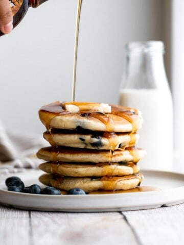 There's nothing better in the morning than thick, soft, fluffy blueberry pancakes, loaded with fresh berries, topped with butter, and soaked in maple syrup.   aheadofthyme.com