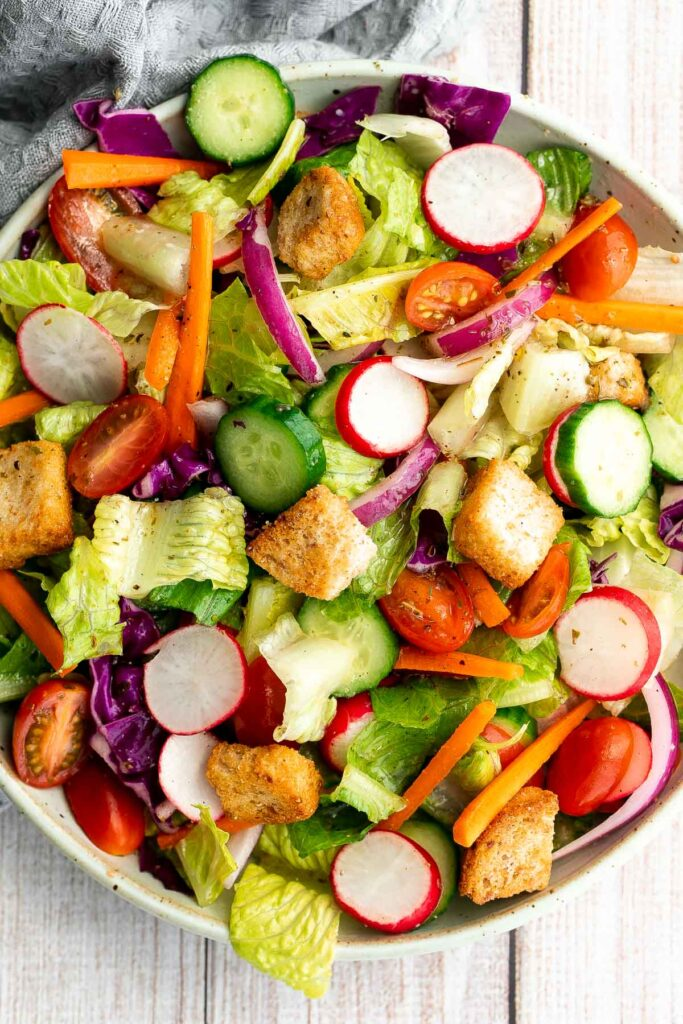 Quick easy homemade garden salad is simple and delicious. Ready in minutes, it's loaded with crisp leafy greens, fresh garden veggies, and crunchy croutons. | aheadofthyme.com