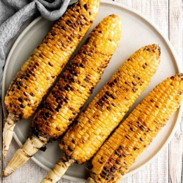 Buttery and salty grilled corn on the cob with beautiful char marks, delicious flavor, and the best texture is the easiest recipe to throw on the grill. | aheadofthyme.com