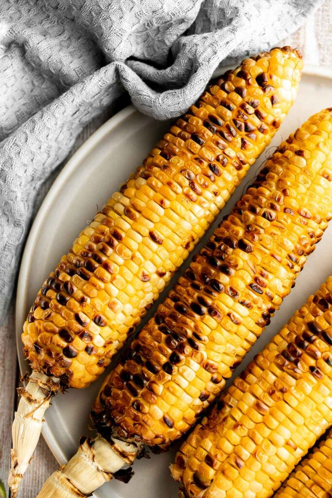 Buttery and salty grilled corn on the cob with beautiful char marks, delicious flavor, and the best texture is the easiest recipe to throw on the grill.   aheadofthyme.com