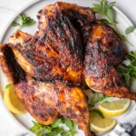 Harissa spatchcock chicken (butterflied chicken) is juicy and tender, has the crispiest skin, and is packed with flavor from red pepper harissa paste.   aheadofthyme.com