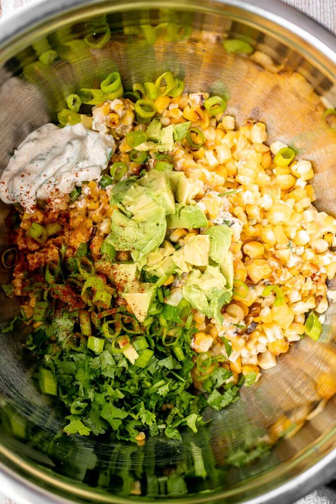 Mexican street corn salad adds a twist to a classic street food, loaded with freshly grilled corn, a creamy cheesy dressing, and authentic flavor. | aheadofthyme.com