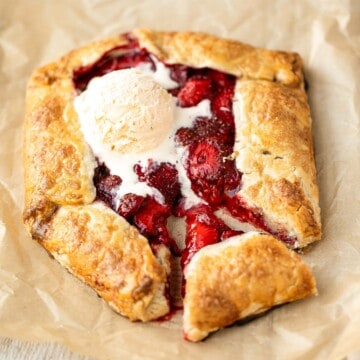 Easier than pie, this strawberry galette with a buttery flaky crust and a sweet and tart strawberry filling is a beautiful treat to serve this berry season. | aheadofthyme.com