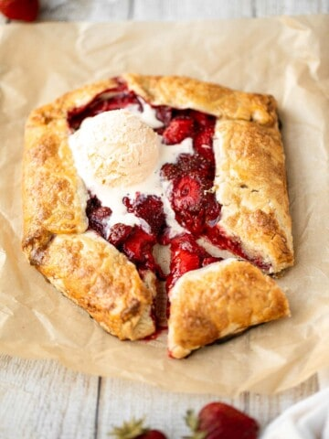 Easier than pie, this strawberry galette with a buttery flaky crust and a sweet and tart strawberry filling is a beautiful treat to serve this berry season.   aheadofthyme.com