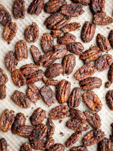 Candied pecans are a delicious, crunchy, and sweet snack during the holidays or great topped on salads and more. Made with five pantry staple in 10 minutes.   aheadofthyme.com