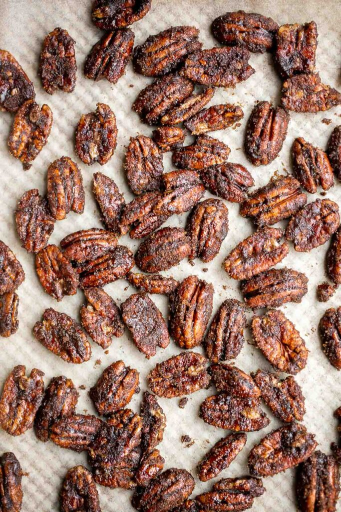 Candied pecans are a delicious, crunchy, and sweet snack during the holidays or great topped on salads and more. Made with five pantry staple in 10 minutes. | aheadofthyme.com