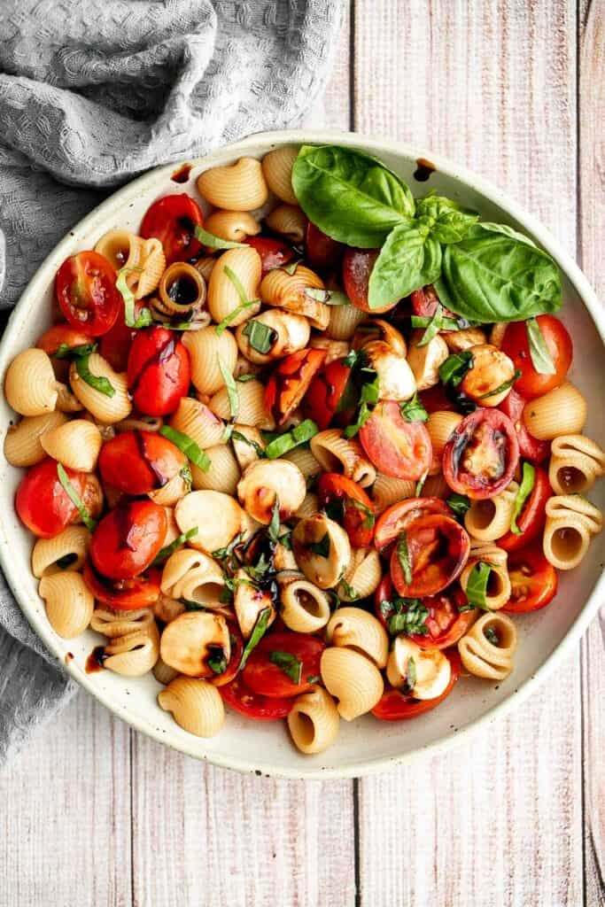 Bright and colorful caprese pasta salad is the ultimate summer side dish. It's fresh, light, and loaded with vibrant summer flavors. Quick and easy too! | aheadofthyme.com