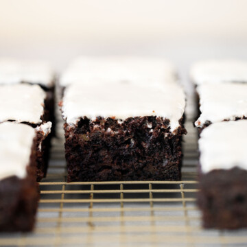 Chocolate zucchini cake is moist, fluffy, and delicious. Loaded with fresh zucchini for a burst of nutrition, and topped with a homemade cream cheese icing. | aheadofthyme.com