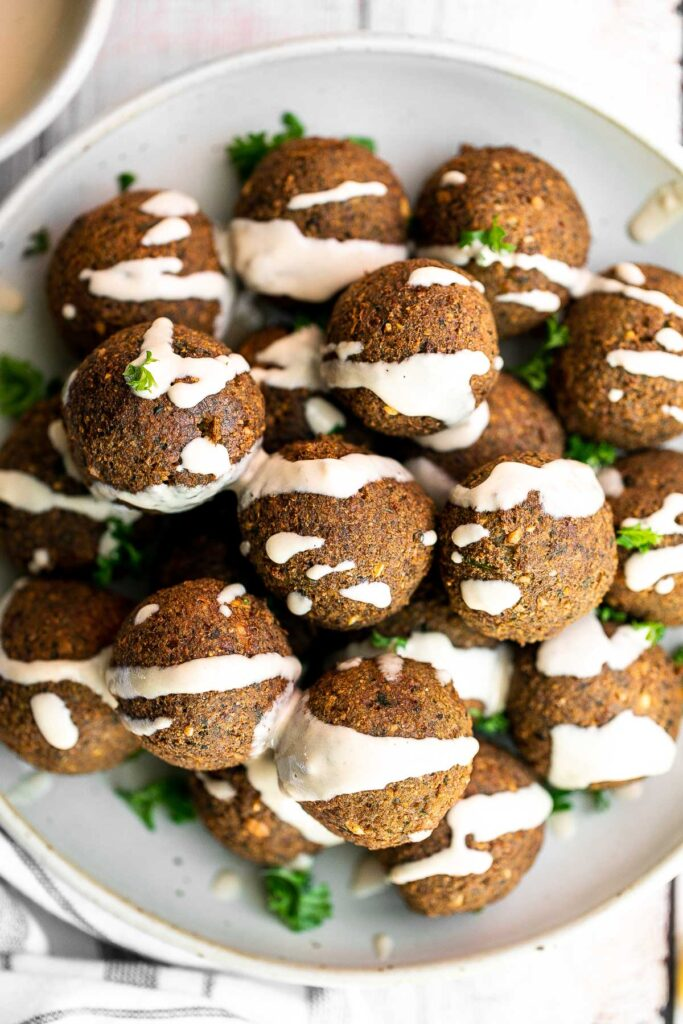 Homemade falafel are delicious, golden brown and crispy on the outside, fluffy tender and soft inside. Plus, they're vegan, loaded with plant-based protein.   aheadofthyme.com
