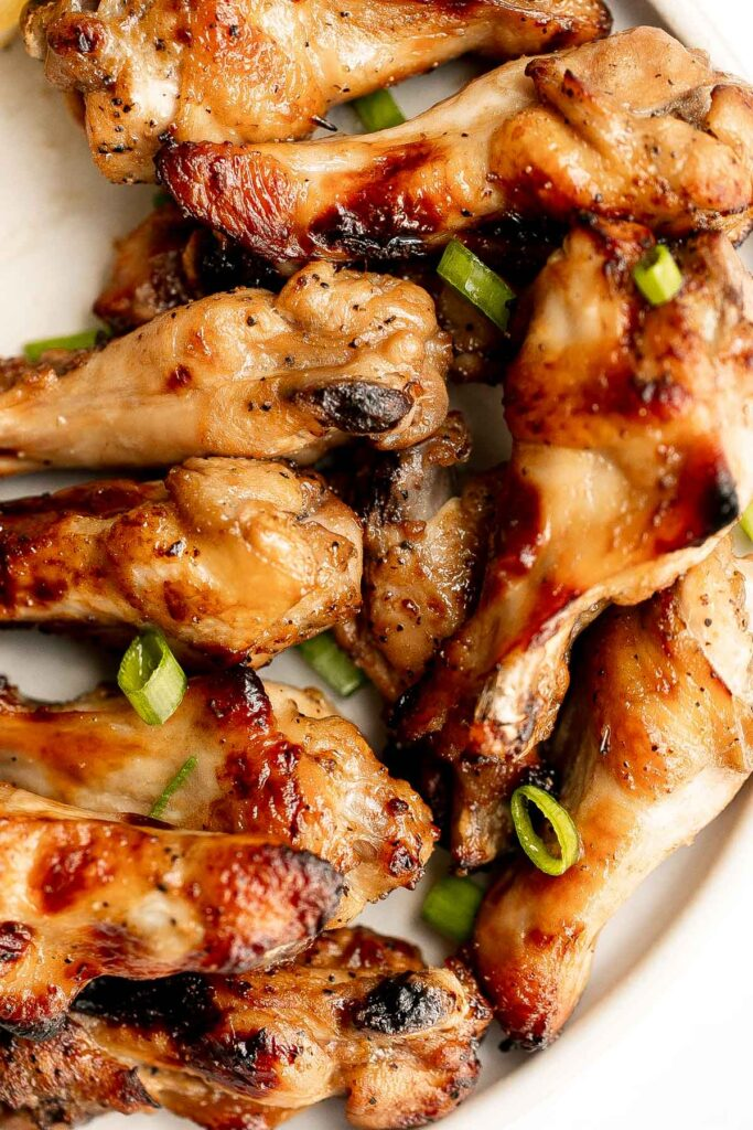 Honey mustard chicken wings are crispy on the outside but juicy and tender inside. Baked in an air fryer or oven, they have the best texture and flavor. | aheadofthyme.com