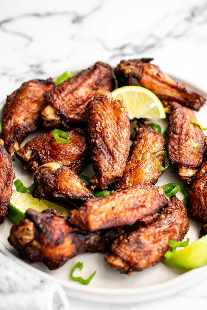 Jamaican jerk chicken wings with delicious crispy skin and tender and juicy meat are loaded with flavor. They're easy to make on the oven, grill, air fryer.   aheadofthyme.com