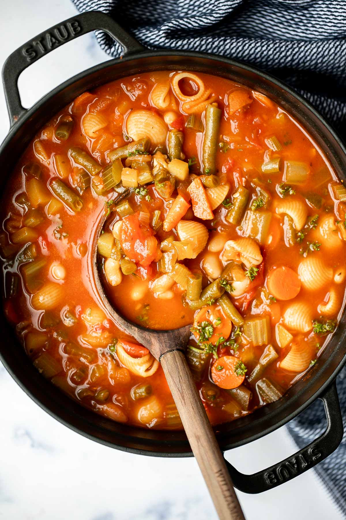 Minestrone soup is a hearty, healthy, nourishing, and delicious classic Italian soup, packed with vegetables and pasta simmered in a rich tomato broth. | aheadofthyme.com