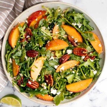 Peach arugula salad with balsamic vinaigrette is an easy delicious summer salad made with a handful of simple ingredients that packs on lots of flavor. | aheadofthyme.com