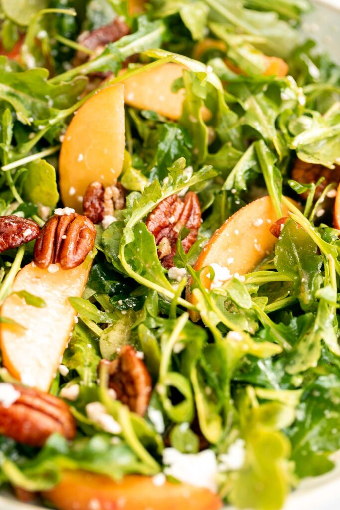 Peach arugula salad with balsamic vinaigrette is an easy delicious summer salad made with a handful of simple ingredients that packs on lots of flavor.   aheadofthyme.com