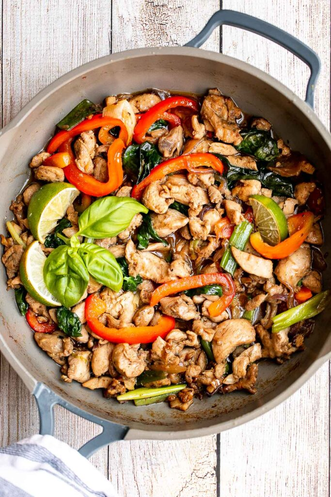 Better than takeout, Thai basil chicken with a delicious homemade sauce is a quick and easy, light and fresh chicken stir fry that is ready in 25 minutes. | aheadofthyme.com