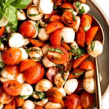 Quick and easy tomato and mozzarella caprese salad is a fresh, light, and delicious summer salad, made with just a few simple ingredients in 10 minutes. | aheadofthyme.com