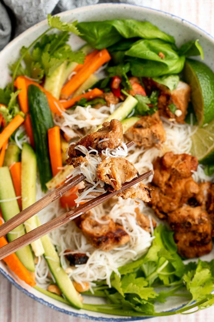 Vietnamese noodle bowl with lemongrass chicken, fresh vegetables and herbs, tossed in a homemade Vietnamese sauce is healthy, delicious, light, and filling. | aheadofthyme.com