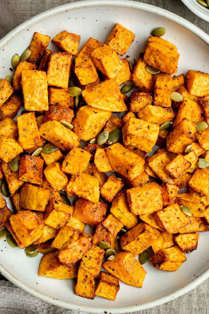 Air fryer butternut squash is a healthy side dish that is crispy on the outside and soft inside. It's faster than roasting in the oven and needs less oil. | aheadofthyme.com