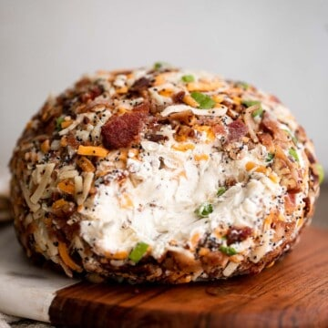 Bacon cheddar cheese ball is an easy to make appetizer and delicious showstopper at holiday parties or game day. It's creamy, cheesy, and nutty. | aheadofthyme.com