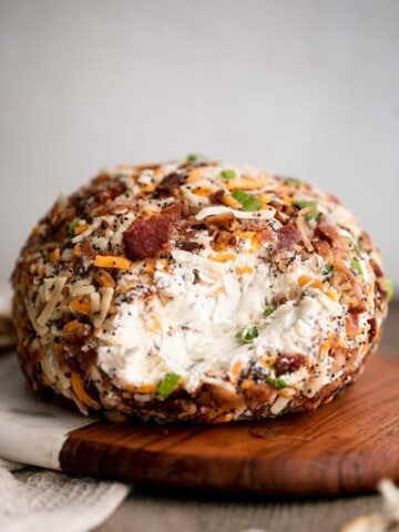 Bacon cheddar cheese ball is an easy to make appetizer and delicious showstopper at holiday parties or game day. It's creamy, cheesy, and nutty.   aheadofthyme.com