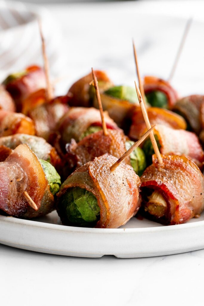 Bacon wrapped brussels sprouts are the sweet, savory, and salty appetizer that you need at your next holiday gathering this fall. Simple and easy to make. | aheadofthyme.com