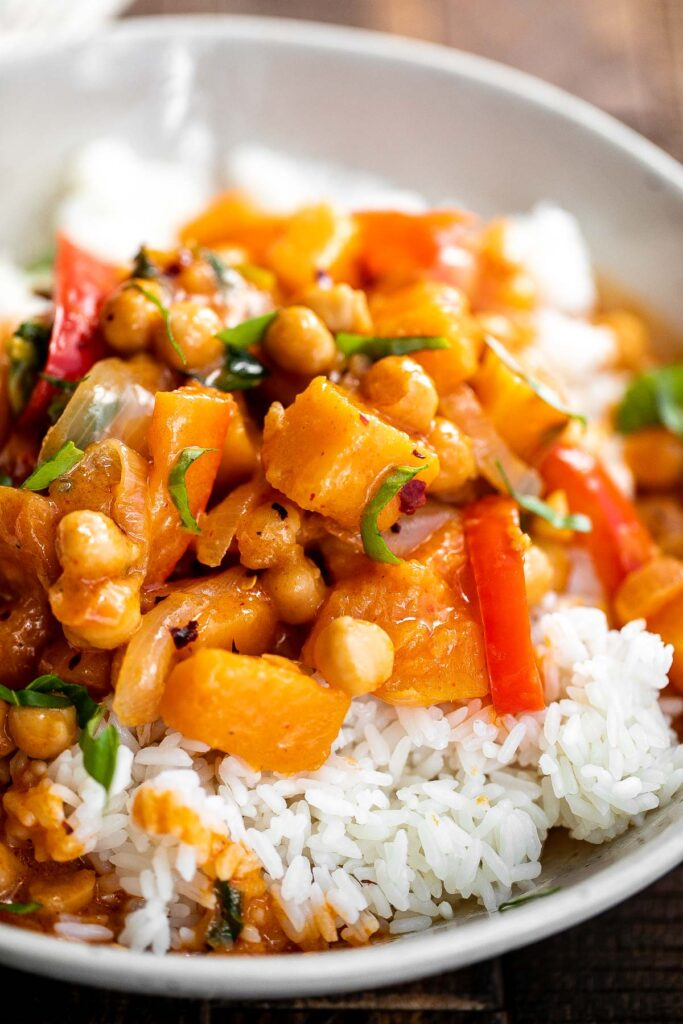 Butternut squash curry with chickpeas is a rich hearty one pot meal that will satisfy your fall comfort food cravings. Great for weeknight family dinners.   aheadofthyme.com