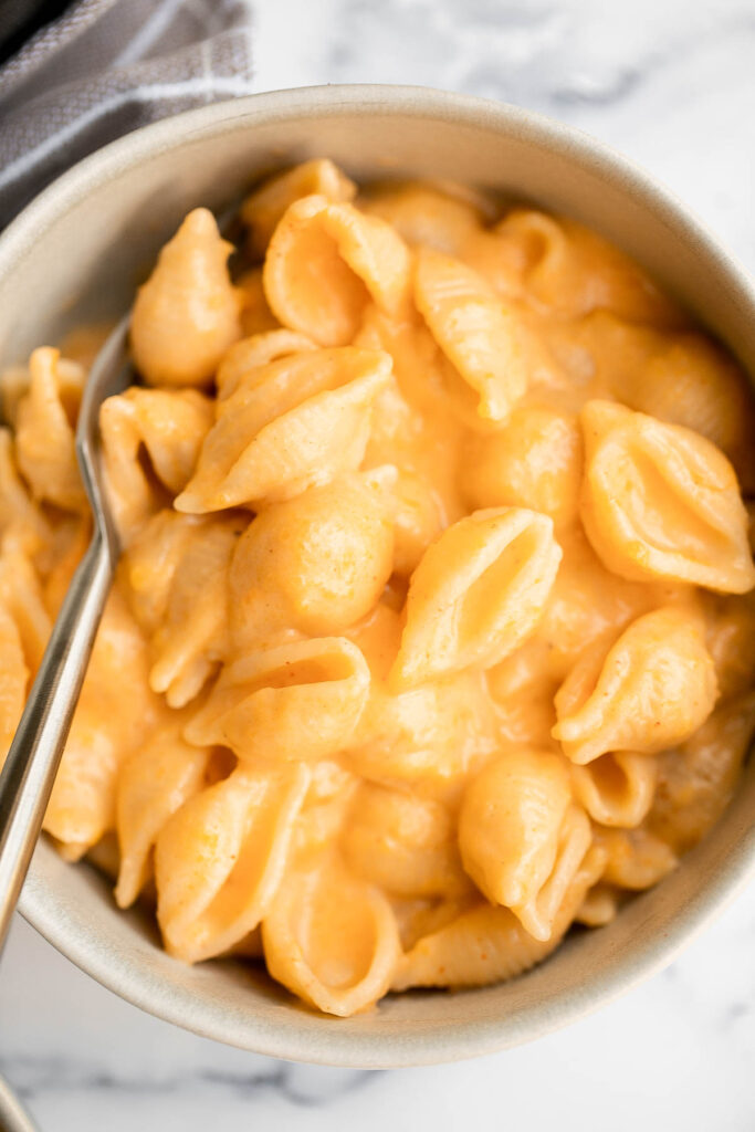 Butternut squash mac and cheese is a flavorful and delicious fall twist on a classic, with a rich and creamy sauce that is secretly loaded with veggies. | aheadofthyme.com