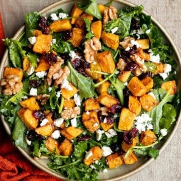 Butternut squash salad is a light meal that's loaded with fall flavors — roasted butternut squash, baby kale, walnuts, dried cranberries, and feta. | aheadofthyme.com