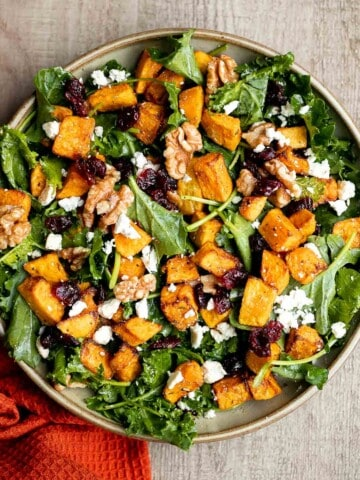 Butternut squash salad is a light meal that's loaded with fall flavors — roasted butternut squash, baby kale, walnuts, dried cranberries, and feta.   aheadofthyme.com