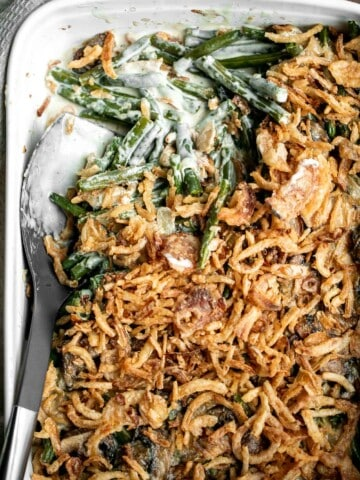 Green bean casserole is a classic holiday side dish packed with fresh green beans in a delicious creamy mushroom sauce, and topped with crispy fried onions.   aheadofthyme.com