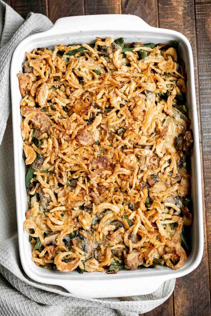 Green bean casserole is a classic holiday side dish packed with fresh green beans in a delicious creamy mushroom sauce, and topped with crispy fried onions. | aheadofthyme.com