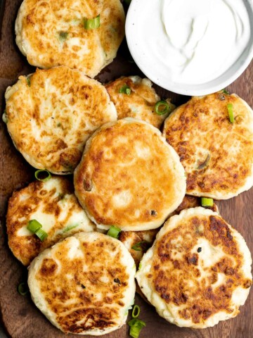 Mashed potato cakes are light and fluffy inside, crispy golden outside, and so delicious and flavorful. The best way to use up leftover mashed potatoes!   aheadofthyme.com
