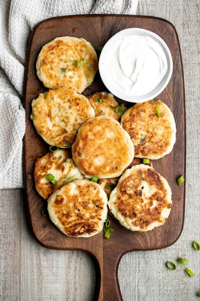 Mashed potato cakes are light and fluffy inside, crispy golden outside, and so delicious and flavorful. The best way to use up leftover mashed potatoes! | aheadofthyme.com